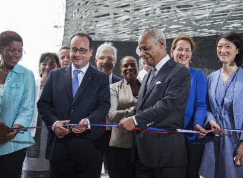 French President François Hollande (2nd L) and of the Regional Council of the French overseas department of Guadeloupe Victorin Lurel (3rd R), flanked by Minister for Ecology, Sustainable Development and Energy Segolene (2nd R) and Culture Minister Fleur Pellerin (R), inaugurate the Memorial ACTe, the Caribbean Centre of Expression and Memory of Slavery and the Slave Trade, in Point-a-Pitre, designed by architects Pascal Berthelot, Jean-Michel Mocka-Celestine, Fabien Dore and Michael Marton on May 10, 2015 the National Day for the Abolition of Slavery and the Slave Trade in France. Francois Hollande is on a five-day visit to the Caribbean, including Martinique, Guadeloupe, Cuba and Haiti.  AFP PHOTO / NICOLAS DERNE